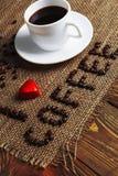 Taza de café y de inscripción Imagen de archivo libre de regalías