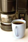 Taza de café y fabricante de café Imagenes de archivo