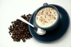 Taza de café y granos de café Fotos de archivo
