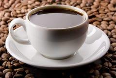 Taza de café y las habas Fotografía de archivo