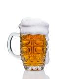Taza de cerveza en el fondo blanco Fotos de archivo