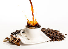 Taza de chapoteo del café Imágenes de archivo libres de regalías