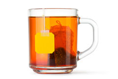 Taza de cristal con la bolsita de té Imagenes de archivo
