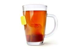 Taza de cristal del té con la bolsita de té Fotografía de archivo