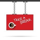 Taza de ejemplo del coffe en letrero rojo Foto de archivo