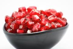 Taza de granadas, jugosa, vitamina, fresca, postre Fotografía de archivo libre de regalías