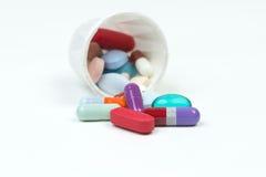 Taza de la medicación Foto de archivo libre de regalías