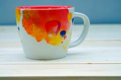 Taza de la naranja del café Fotos de archivo libres de regalías