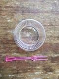 Taza de la salsa de inmersión del plástico transparente Fotos de archivo