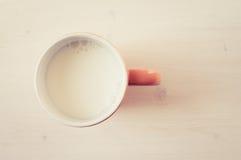 Taza de leche Foto de archivo libre de regalías