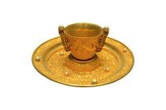 Taza de oro y placa Fotografía de archivo