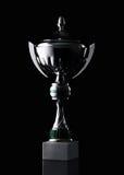 Taza de plata del ganador en fondo negro fotografía de archivo libre de regalías
