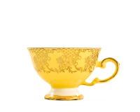Taza de té amarilla de la vendimia Imagenes de archivo