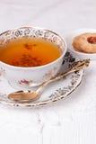 Taza de té antigua Imágenes de archivo libres de regalías