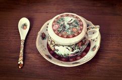 Taza de té antigua Imagenes de archivo