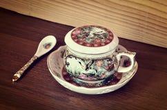 Taza de té antigua Fotografía de archivo