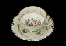 Taza de té antigua Foto de archivo libre de regalías