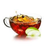 Taza de té con el chapoteo Imagenes de archivo