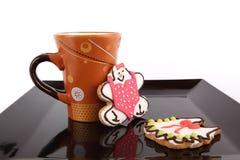 Taza de té con el dulce funy Fotos de archivo libres de regalías