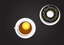 Taza de té con el limón y el buñuelo Imágenes de archivo libres de regalías