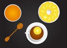 Taza de té con el limón y la miel Imagenes de archivo