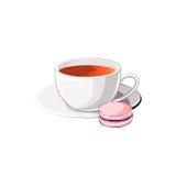 Taza de té con el macaron Foto de archivo libre de regalías