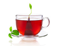 Taza de té con la bolsita de té Fotos de archivo libres de regalías
