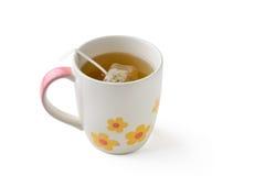Taza de té con la bolsita de té Foto de archivo libre de regalías
