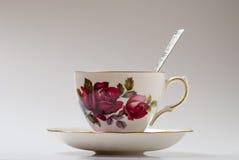 Taza de té con la cuchara Imágenes de archivo libres de regalías