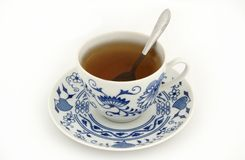 Taza de té con la cuchara foto de archivo