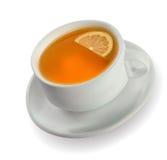 Taza de té con un limón Foto de archivo libre de regalías