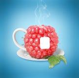 Taza de té de la frambuesa Fotos de archivo