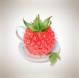 Taza de té de la frambuesa Fotografía de archivo