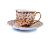 Taza de té de la porcelana en el fondo blanco Fotografía de archivo