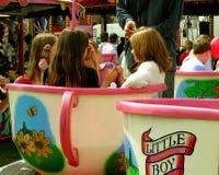 Taza de té de las muchachas Imagen de archivo libre de regalías