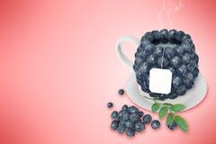 Taza de té del arándano Foto de archivo