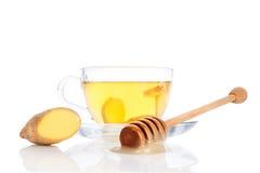 Taza de té del jengibre con la miel. Imagenes de archivo