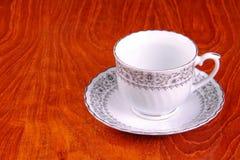 Taza de té en fondo de la madera contrachapada Fotografía de archivo libre de regalías