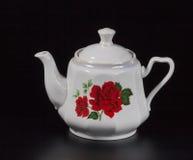 Taza de té en un fondo negro Fotos de archivo libres de regalías