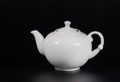 Taza de té en un fondo negro Fotografía de archivo