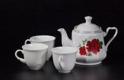 Taza de té en un fondo negro Imagen de archivo libre de regalías