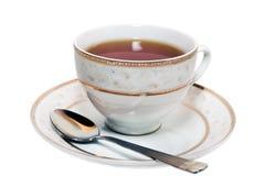 Taza de té en un platillo Fotografía de archivo