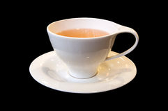 Taza de té. fondo negro Imagen de archivo