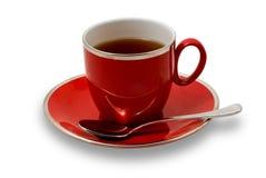 Taza de té llena y platillo rojos aislados en blanco Fotos de archivo