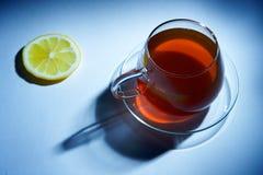 Taza de té negro Foto de archivo