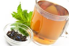 Taza de té negro condimentado Imagenes de archivo
