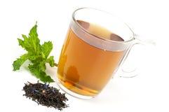 Taza de té negro condimentado Fotos de archivo