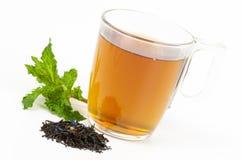 Taza de té negro condimentado Imagen de archivo libre de regalías