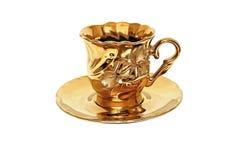 Taza de té de oro Fotos de archivo libres de regalías