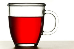 Taza de té rojo Foto de archivo libre de regalías